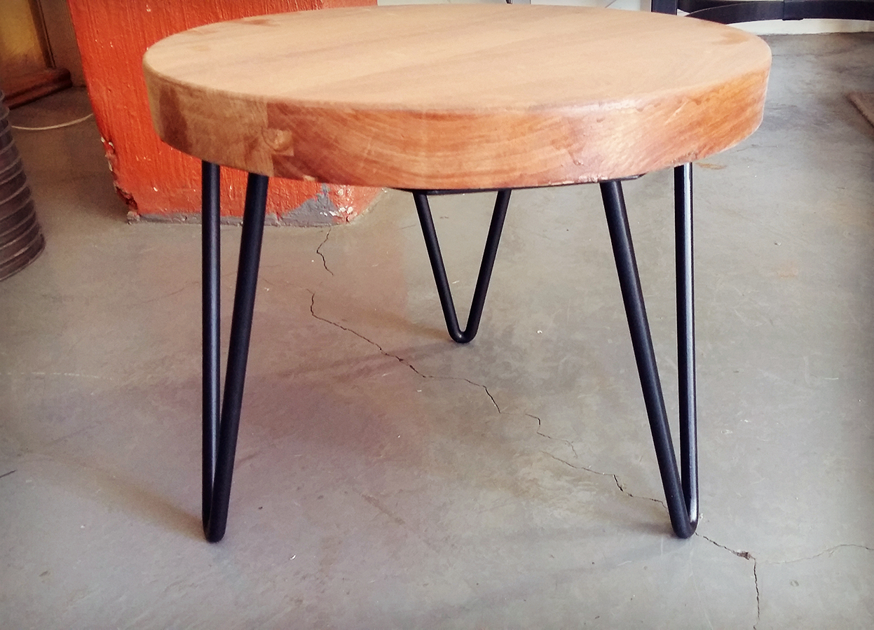 wooden table with iron legs